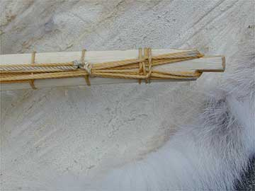 Cable-backed bow